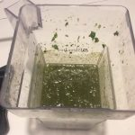 photo of purees spinach in a blended blender jar