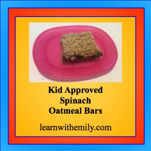 Photo of an oatmeal bar on a pink plate with the caption: kid approved spinach oatmeal bars, learn with emily dot com