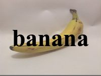 a photo of a banana with the word banana superimposed over the image