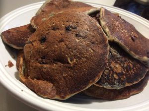 whole wheat blueberry pancake recipe with cooked pancakes on a plate
